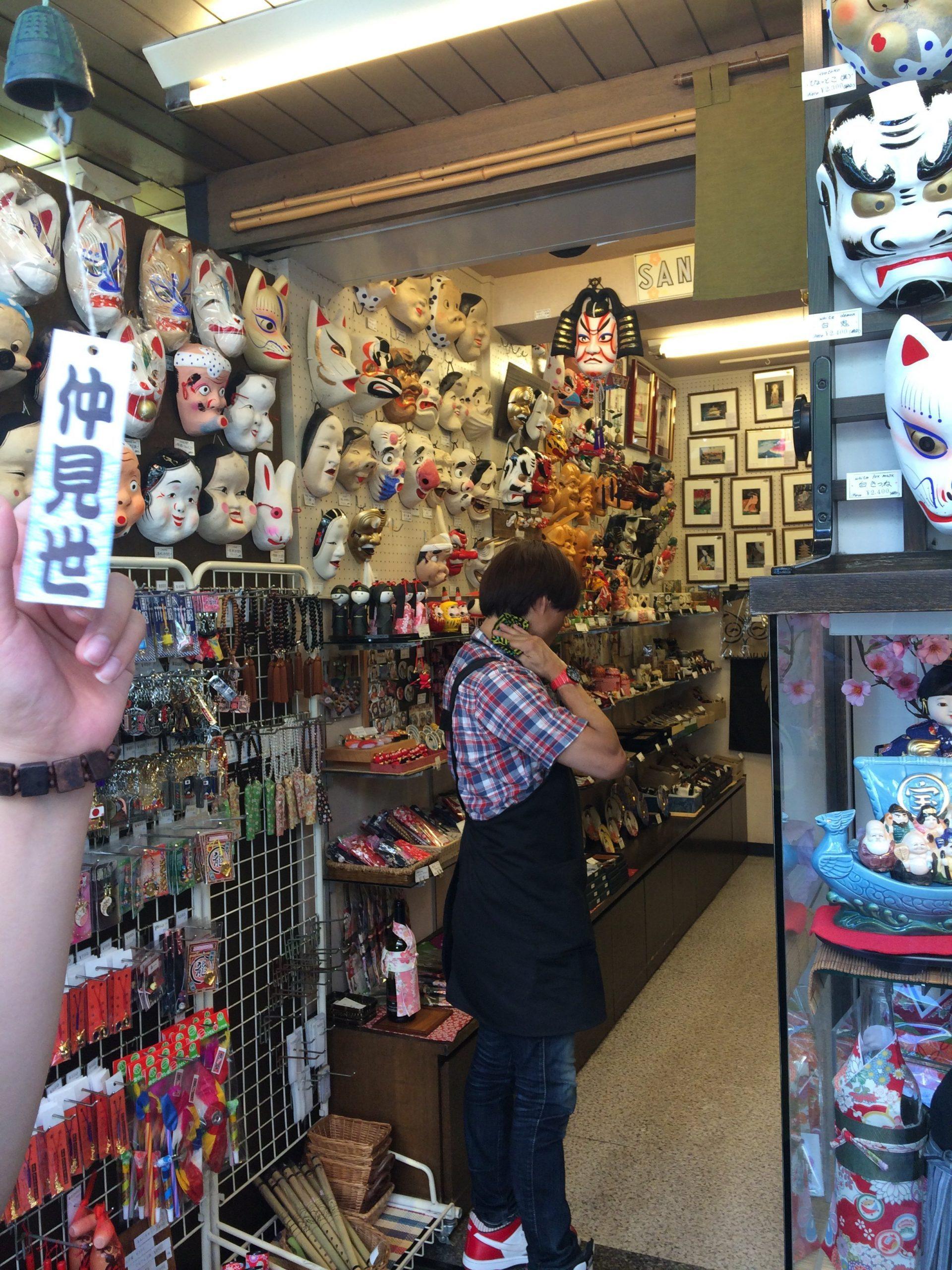 a souvenir shop sells japanese traditional masks