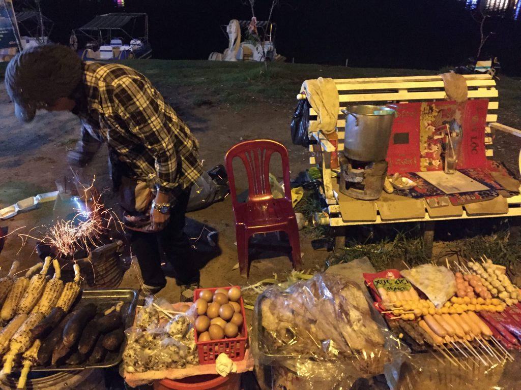 A stall of street-food around Xuan Huong lake