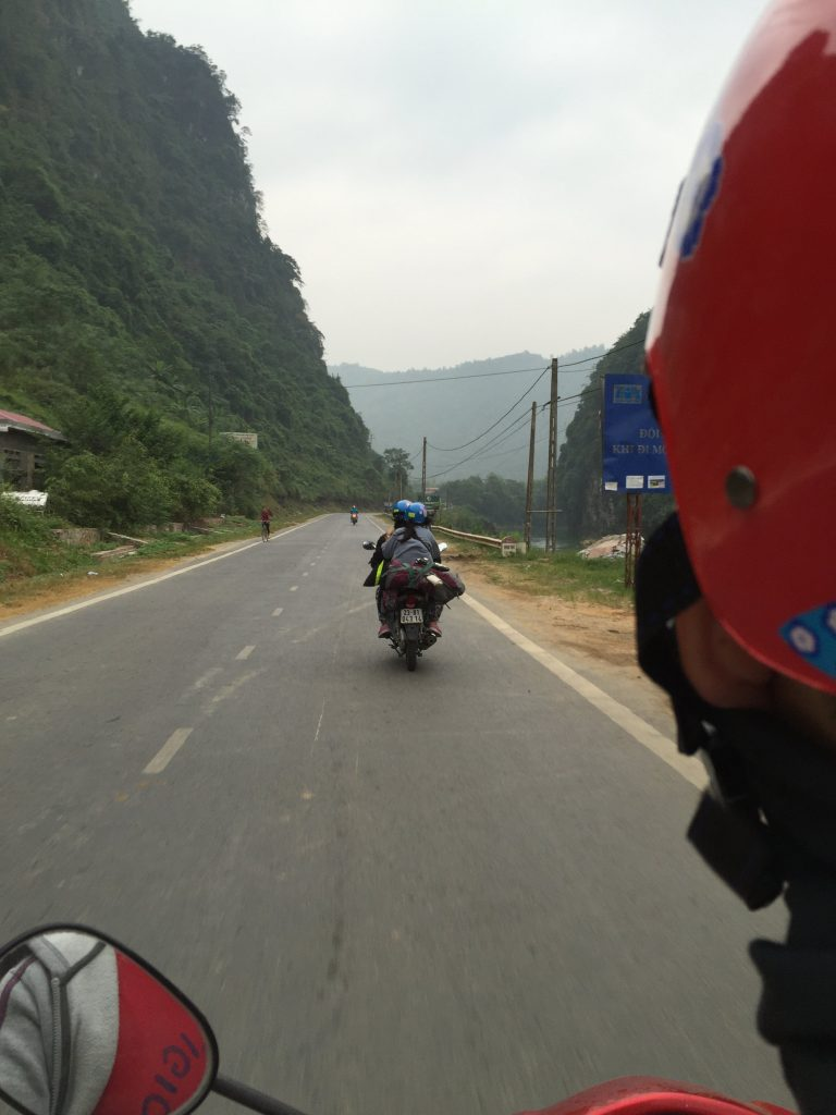 Riding motorbike on the road of Ha Giang, Vietnam