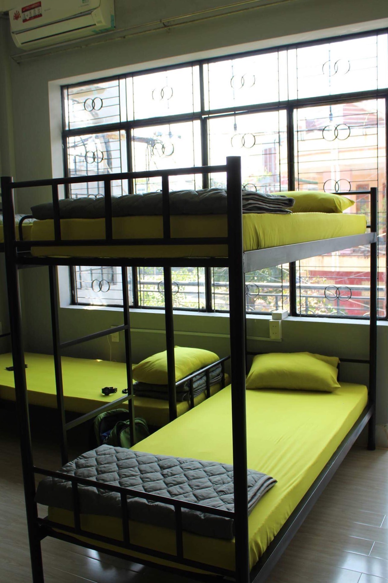 green beds at O.M.E hostel - Quy Nhon, Vietnam