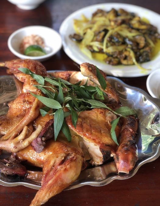 Grilled chicken with honey at a restaurant inside tra su melaleuca forest, vietnam