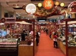 Chinese people selling lunar new year products at Takashimaya, a mall in Singapore