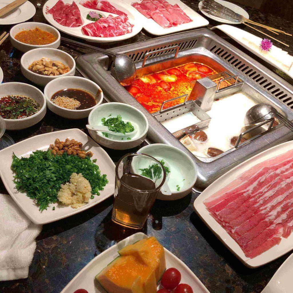 Haidilao hotpot with meats and condiments