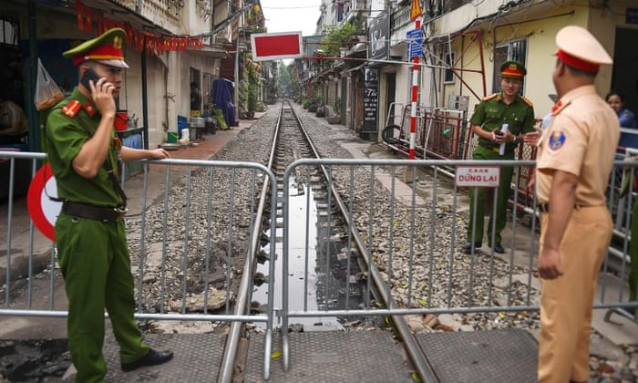 Hanoi train street closed. Police officers request visitors to turn out