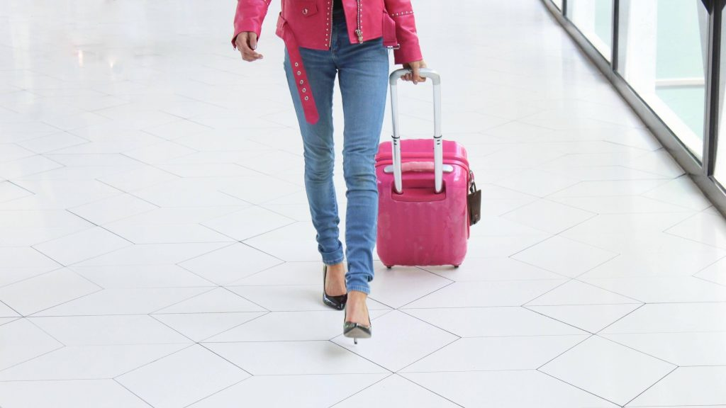 a woman pull a suitcase
