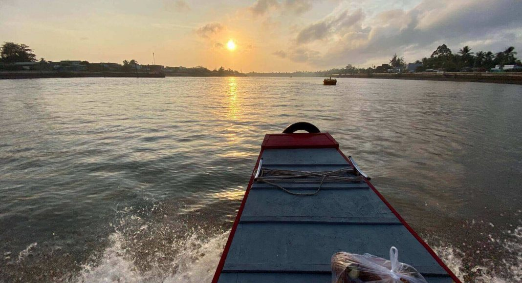 Riding boat to floating market at Ninh Kieu river, Can Tho, Vietnam