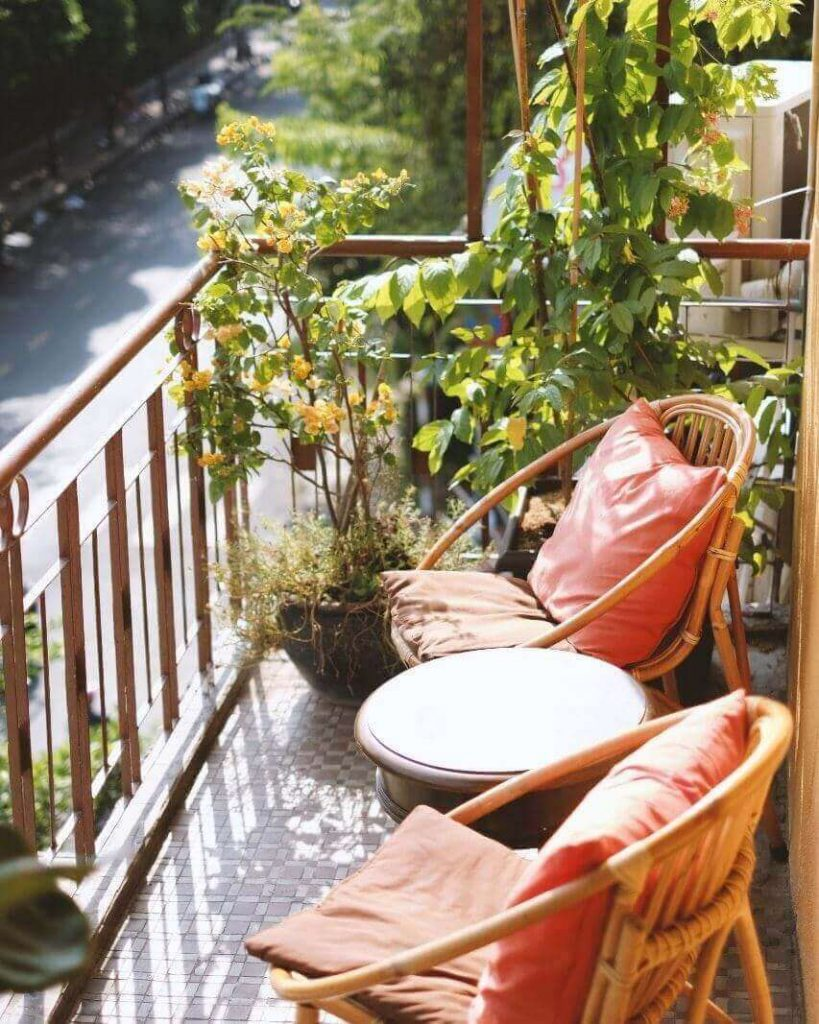 The chairs and table on the balcony of Little Ha Noi Egg Coffee