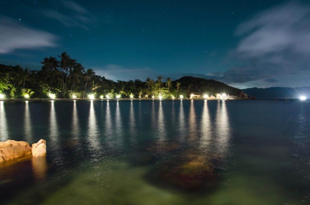 Whale Island Resort and the bungalow at night