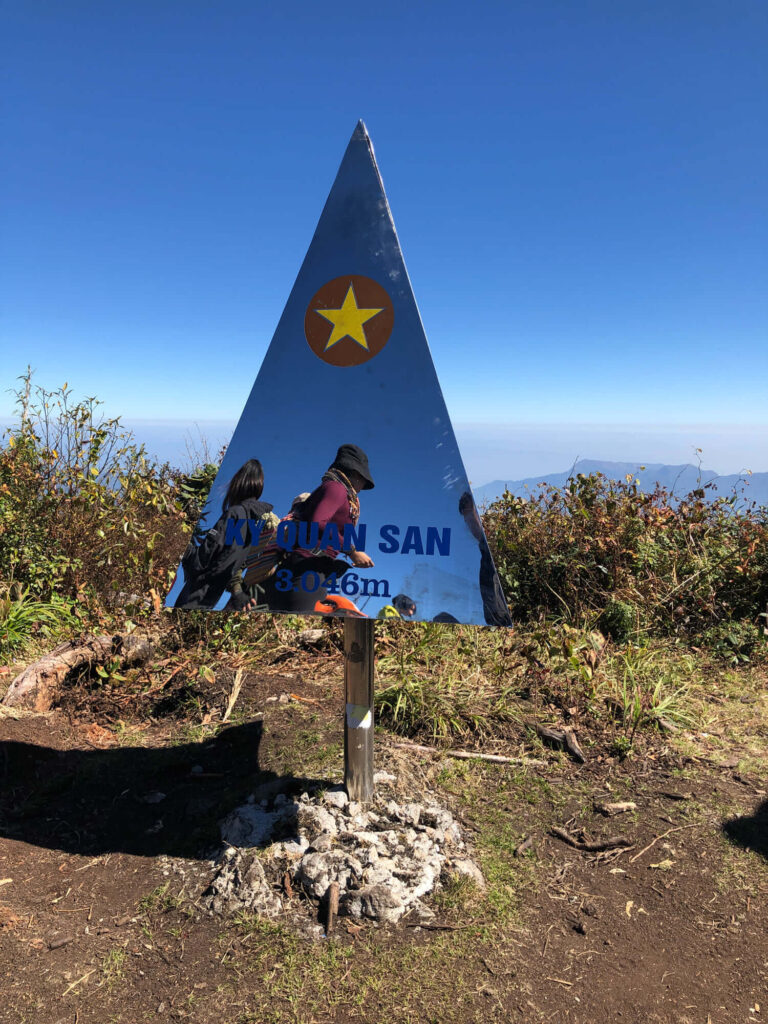 The stainless steel triangle marks the peak of Bach Moc Luong Tu