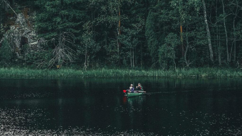 kayaking on a lake inside forest