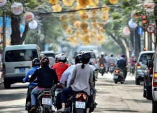 riding motorbike on the street of Saigon in spring