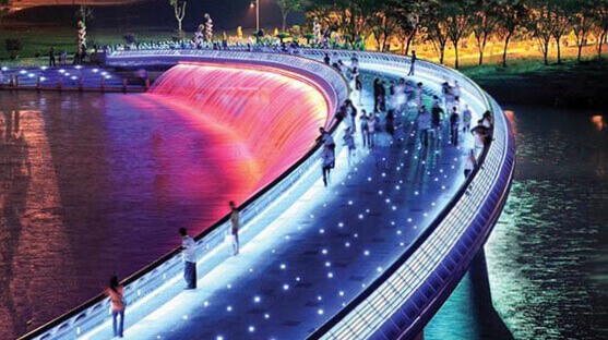Starlight bridge with LEDs and colorful water fountain system at night